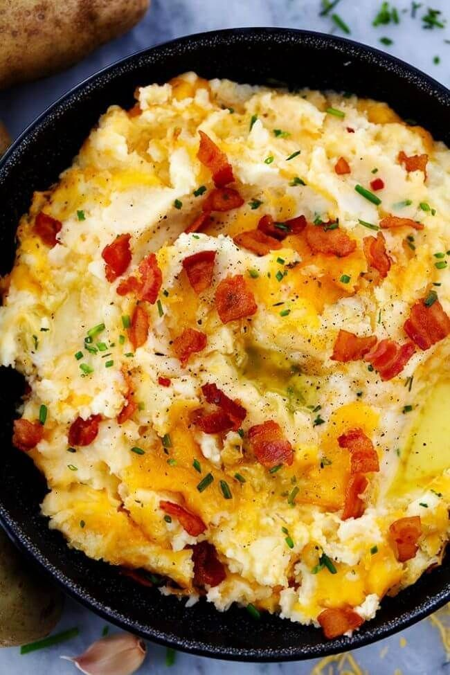 This Cheddar Garlic Mashed Potato Casserole is loaded with the most delicious creamy mashed potatoes, garlic, cheddar, and will be a huge hit at dinner!