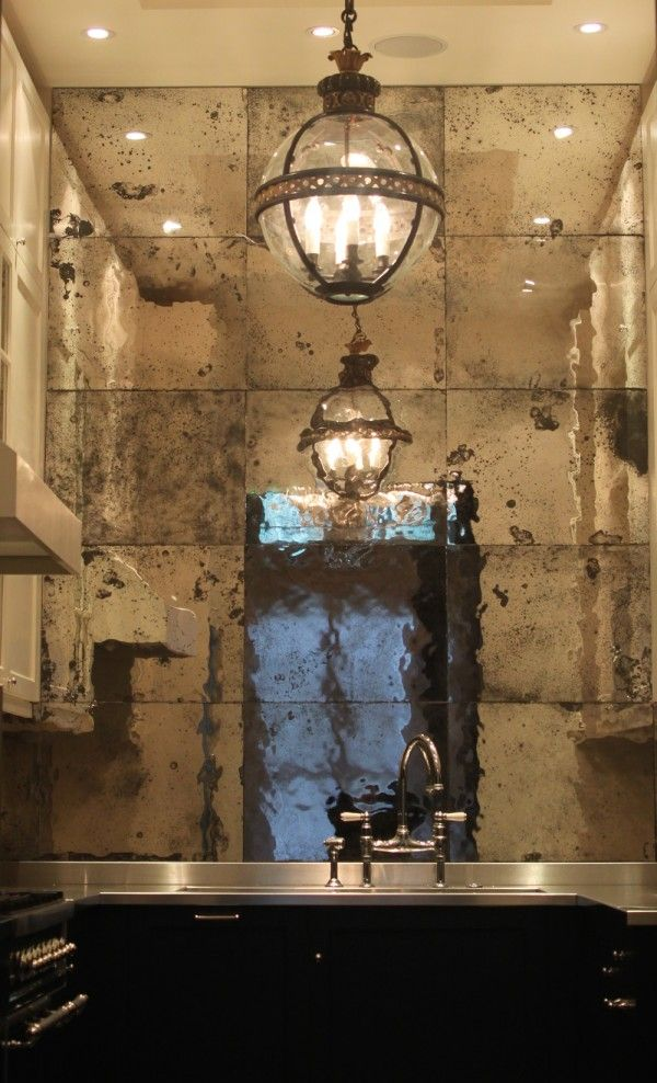 Like these mirrors and lighting for an entry - makes and interesting kitchen though
