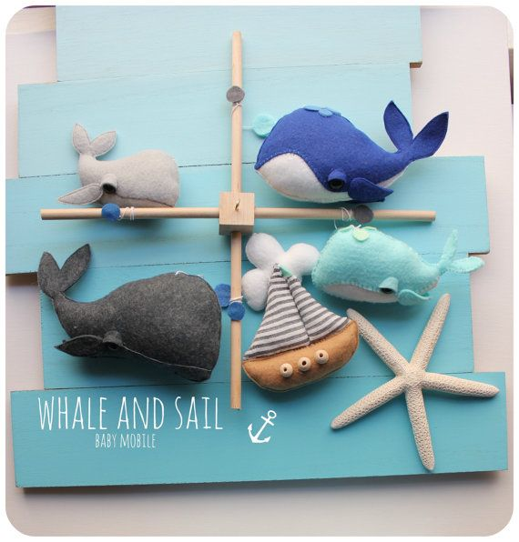 Beautiful and Unique all handmade from my original design. A novelty Ocean baby mobile with whales and tiny boat. Perfect for an Ocean creatures themed Baby shower or beautiful centerpiece in a nautical nursery. Only made with high quality materials in Europe. I take pride in my work and attention to details. You will receive: -Four whales (in colors of charcoal, silver, deep blue and teal), - a Tiny sailing boat with small cloud, wooden base with gold hook on top. The product is fully…