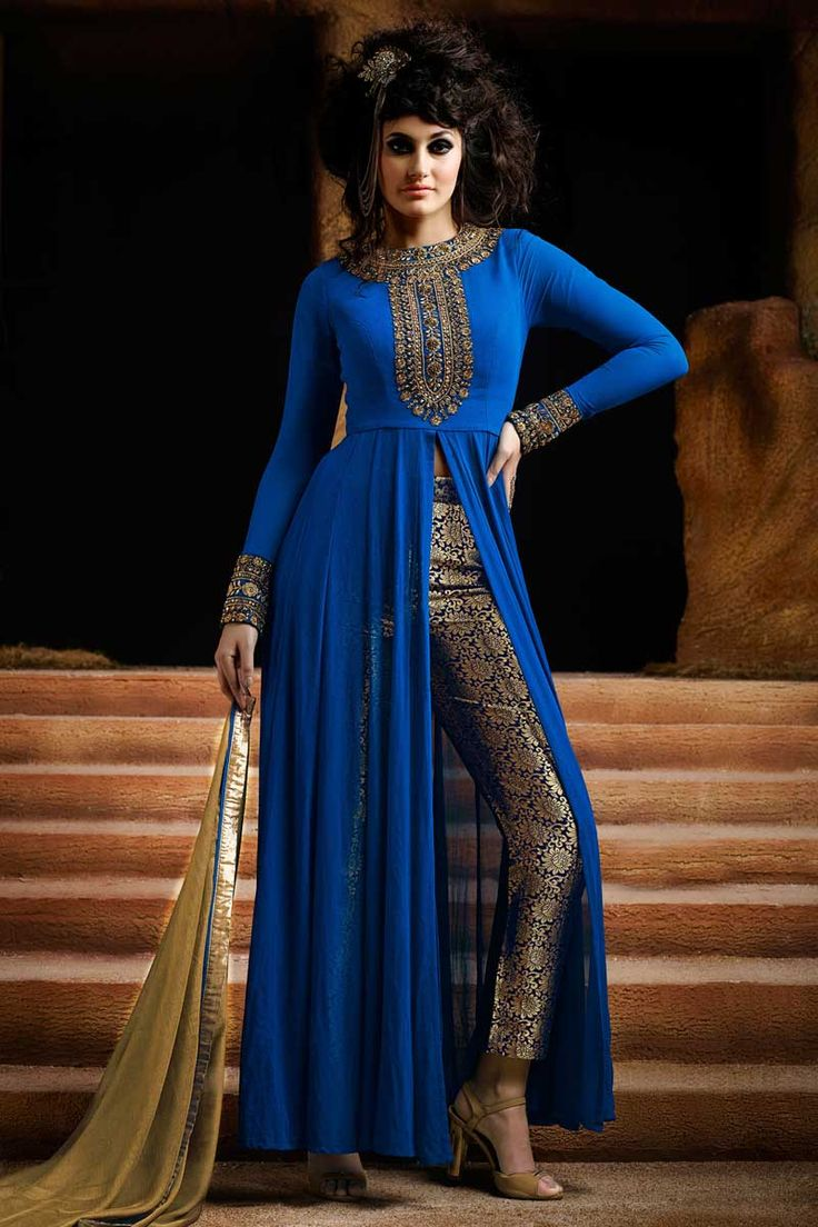 Blue Georgette Trouser Suit With Dupatta Blue georgette, semi stictch trouser suit. Neck embroidered with work. Band collar neck, Ankle length, full sleeves kameez. Blue brocade trouser. Beige chiffon dupatta with lace border with work. Product are available in 34,36,38,40 sizes. It is perfect for casual wear, festival wear, party wear and wedding wear.