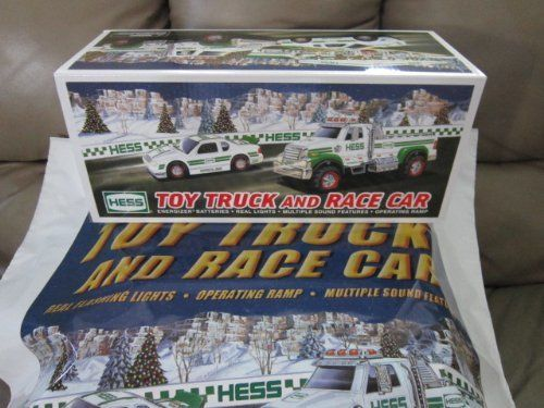 2011 Hess Toy Truck and Race Car by Hess. $19.95. Truck with 4 wheel independent suspension, pushbutton activated. Race Car with pullback motor and working lights. 2011 Hess Toy Truck and Race Car. 2011 Hess Toy Truck and Race Car This heavy duty, flatbed utility style truck is loaded with chrome detailing and working lights. Truck features 4-wheel independent suspension, pushbutton activated ignition, horn and backup alert sounds and a hidden driving ramp with hydraulic sound. ...