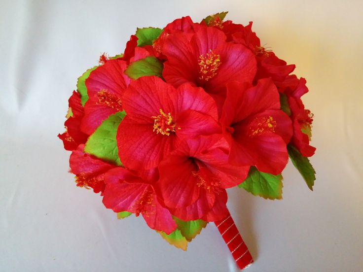 red hibiscus wedding bouquet for destination wedding or traditional wedding with an exotic wedding bouquet.  From www.hibiscusbeachweddingflowers.com