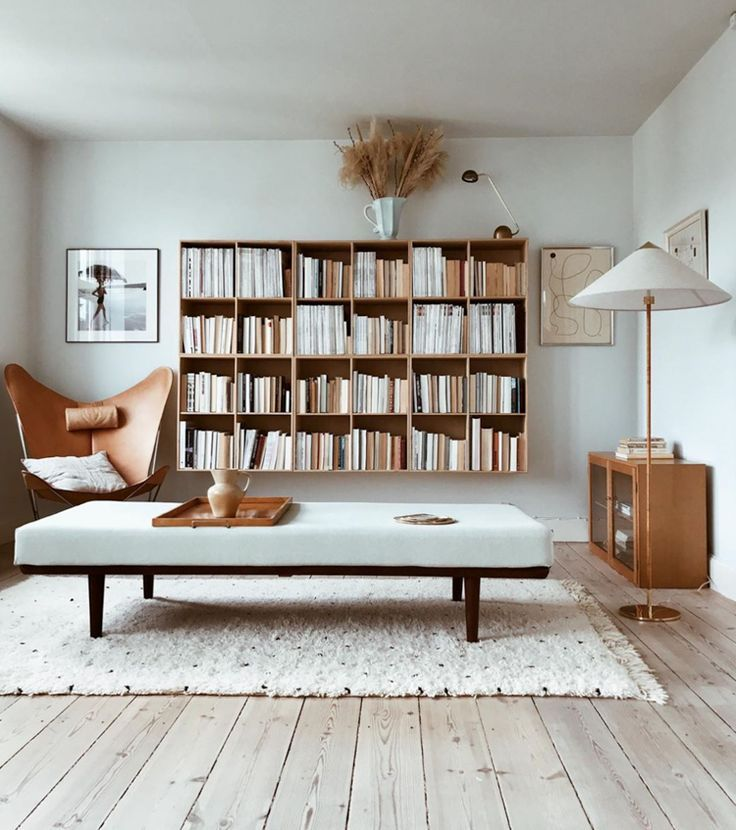 Books, Art and Golden Tones in a Beautiful Copenhagen Living Room.