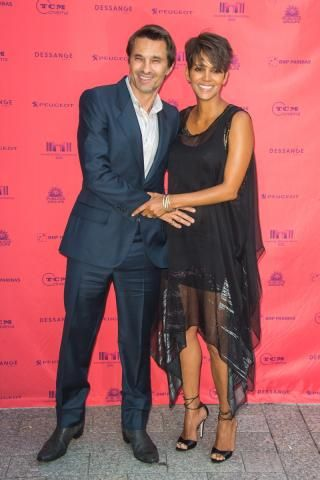 """After two years of marriage, Halle Berry filed for divorce from French actor Olivier Martinez. """"It is with a heavy heart that we have come to the decision to divorce,"""" the couple said in a joint statement. """"We move forward with love and respect for one another and the shared focus for what is best for our son."""" Berry and Martinez have a two year old son together, Maceo. DOMINIQUE CHARRIAU/WIREIMAGE"""
