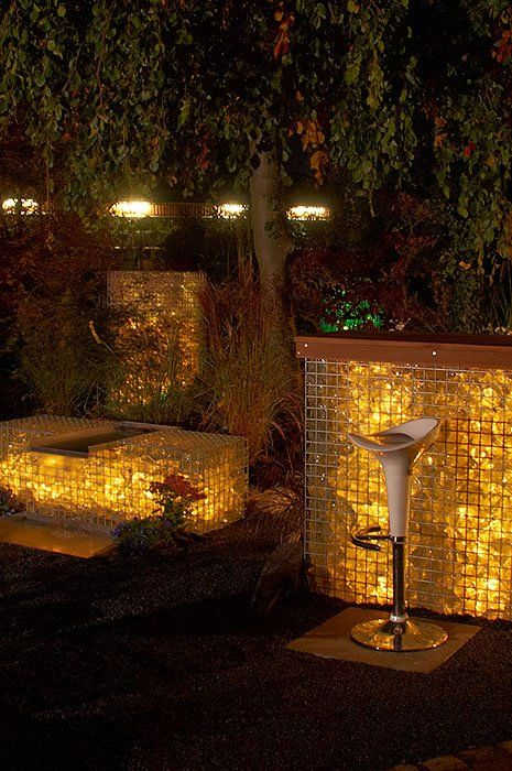 gabion walls with coloured LED lights inside (Still too heavy handed, but better).
