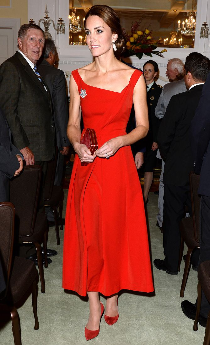 Kate Middleton in a red tea-length dress