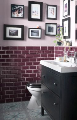 A small, decorated bathroom with a reading nook and shelving unit for extra storage space