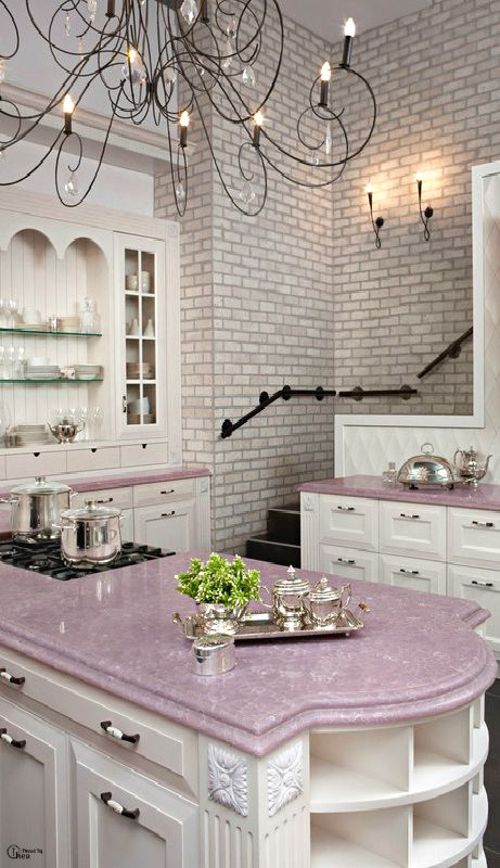 A lavender countertop?! Not sure I'd be brave enough to be THAT unique, but if I knew I would love it for the rest of my life and wasn't planning on selling the house, I'd be really tempted! I LOVE the staircase coming down to the kitchen :) I've always wanted a back staircase.