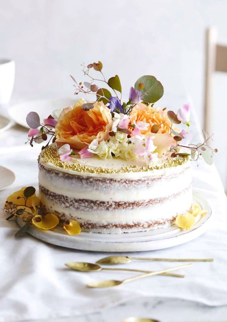 Layered carrot cake topped with flora.