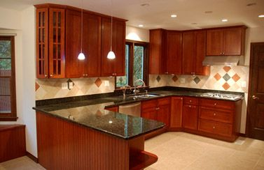 Elegant Cherry Cabinets with Granite Countertops Pictures