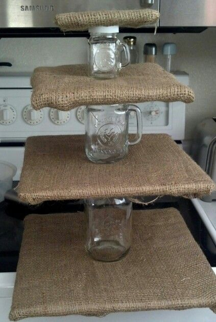 Burlap and Mason jar cupcake stand. There I no link for this, but I know that Ben could figure something out