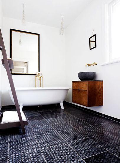Look We're Loving: Masculine Bathrooms Black & white theme, subway tile, and black flooring.