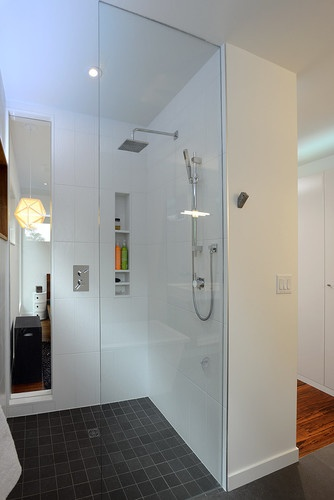 Love the large white tile and rectangle grey floor.   Master ensuite shower modern bathroom