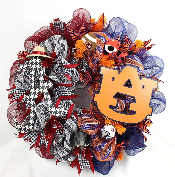 Alabama Crimson Tide Auburn Tigers House Divided Deco Mesh Door Wreath. House Divided? No Problem Crazyboutdeco has you covered.The Alabama side features deluxe Crimson, Black and White Deco Mesh, a Big Al Elephant, Hand Painted A logo ,and topped off with a licensed Riddell Crimson Tide Helmet and a Saban Hat.The Auburn Side features deluxe Orange and Navy blue Deco Mesh, with a cute little Auburn tiger,and topped off with a licensed Riddell Auburn tigers helmet. The wreath measures 24...