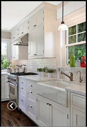 gorgeous white kitchen with hardwood floors