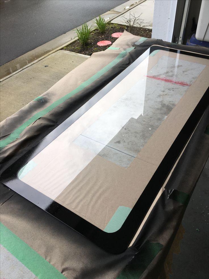 Plexiglass with painted trim to hide interior window edge