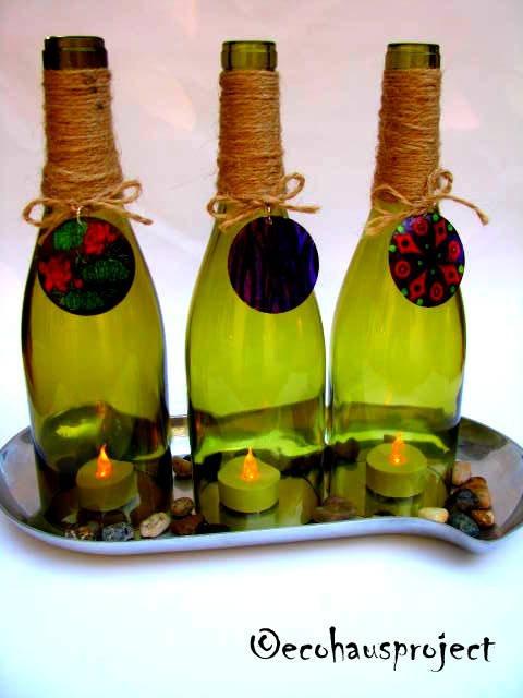 Wine bottles, Wine Lovers Gift, Rustic/Outdoor/Garden Wedding/Beach WEdding, home decor, Hurricane lamp SET of 3, lantern, candle holder. $30.00, via Etsy.
