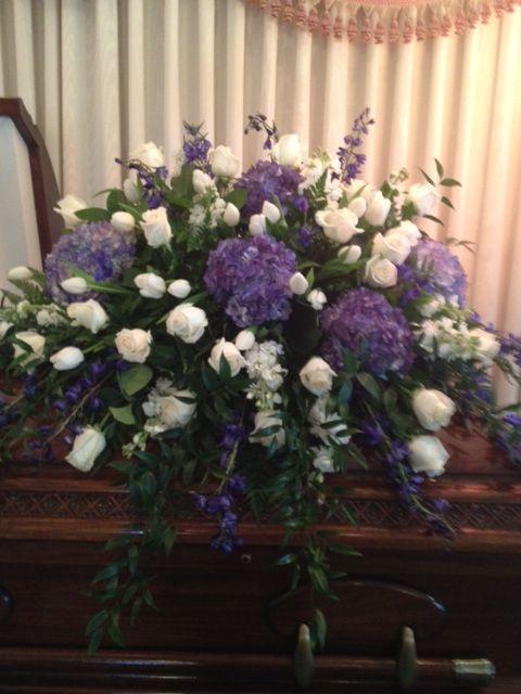Purple and white casket spray