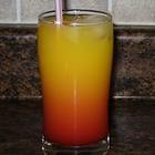 Tequila Sunrise    1 1.5 oz jigger tequila  3/4 cup freshly squeezed orange juice  ice cubes  1/2 1.5 oz jigger grenadine syrup  1 slice orange (garnish)