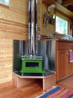 cutest tiny wood stove ever-Sardine Wood stove http://www.marinestove.com/sardineinfo.htm Sardine model - 12 x 12 x 11 Inches, Weighs 35 Lbs 86 % Efficient