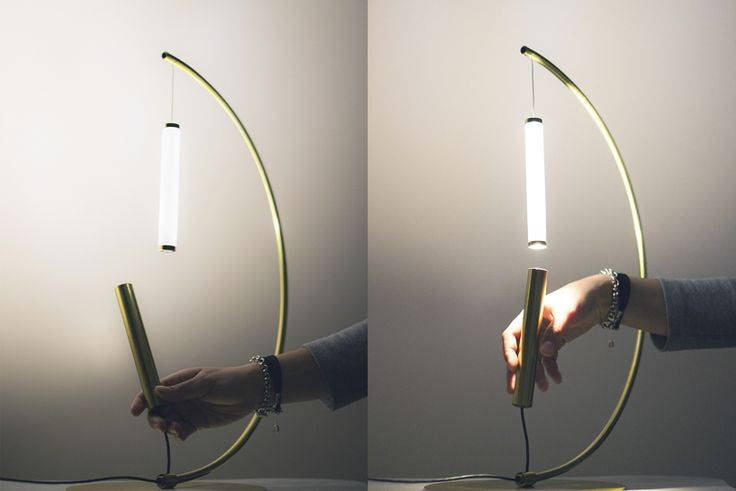 presented at milan design week 2017, EQUILIBRIO is made of two symmetric tubes that, once close enough, let the lamp magically float in a constant state of equilibrium.