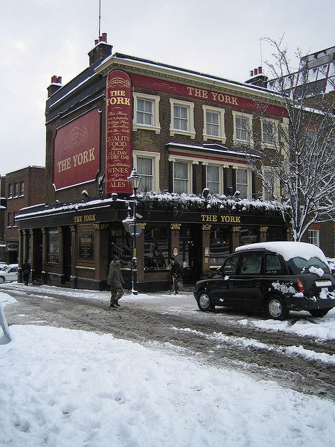 The York, Angel, Islington, Greater London, London, England, Great Britain, United Kingdom. Until the late 18th Century, the site of The York was open fields and part of a farm. It was first established as The York Hotel in 1851 and dairy cows once grazed up to the back door. An historic print from 1819 shows a view from outside the pub, with St. Mary's Church and bare-knuckle prize fighting on the green.