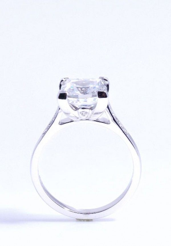 2ct Cushion cut diamond ring with diamond details in the cleft of the claws, By top Jewellery Designers