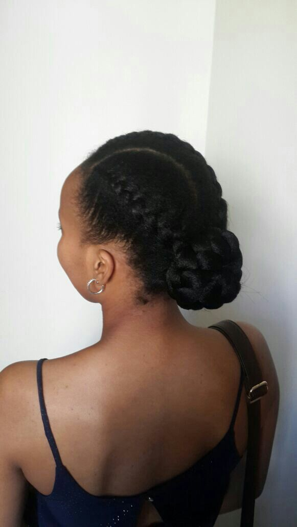 my first ever commercial hairdo. 2 strand cornrows with a low bun. finesse