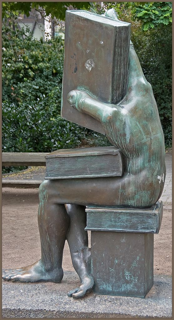 """Very interesting sculpture. """"Der Buchhändler"""" [The Book Seller, literally: """"somebody who handles books""""] on the Ludwig-Metzger-Platz in Darmstadt, Germany. Sculpture by Michael Schwarze, photograph by Neil Gallop."""