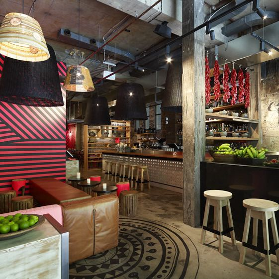 Aztec-like circular motifs feature underfoot, and both wall and floor decorations are hand-painted. There's an overall roughness to the place from the brick, breeze block table supports and huge logs employed as seats...