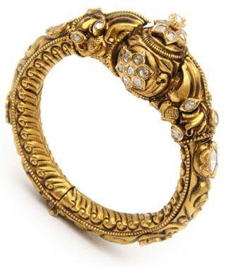 Dull finish gold bracelet with uncut diamonds by Krishniah Chetty.