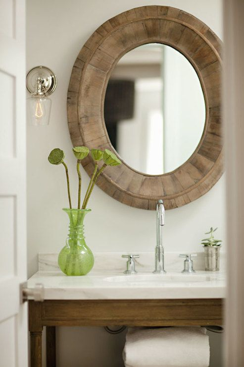 Images Of Chic powder room features Restoration Hardware Pieced Oval Mirror flanked by glass and chrome sconces over