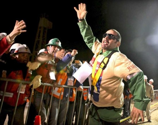 A handout photograph made available on 13 October 2010 by the the Government of Chile showing Chilean miner Mario Sepulveda (R), after being rescued, celebrating after leaving the Fenix rescue capsule during the rescue operation at the San Jose mine near Copiapo, Chile, on 13 October 2010. Sepulveda, 39, is a electrician of the group of 33 miners trapped at the San Jose mine since an accident at the premises on 05 August 2010.  EPA/HUGO INFANTE / GOVERNMENT OF CHILE / HANDOUT MANDATORY…