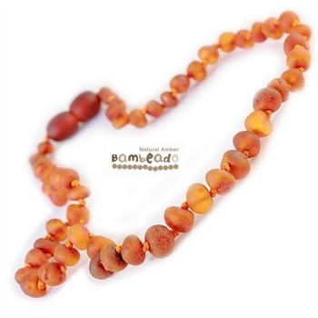 Looking for something unique? This gorgeous premium raw amber necklace comes in cognac. The amber necklace is approx 33 cm in length. Bambeado amber is genuine baltic amber. Bambeado's are to be worn and not chewed. Each bead is individually knotted to help with safety.  The Bambeado comes together with a plastic screw clasp. The Bambeado is designed to give way at the clasp or one bead will only break off if broken. Supervision is always recommended for children under the age of 3.