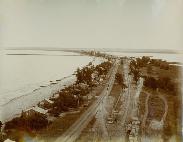 Hamilton Beach Strip. This view of the beach, looking south, was taken from the top of the brick power house for the Hamilton Radial Electric Railway in the 1890s. Also shown are the tracks for the Hamilton & North Western Railway (on the left), presently the Hamilton Rail Trail, and the Hamilton Radial track, on the right. Photograph by Charles S. Cochran.