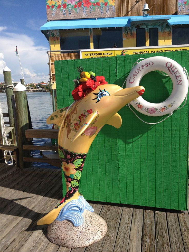 """Calypso Gal"" dolphin, done by artist Lisa Holt, is in front of the Calypso Queen at #Clearwater Beach marina.  Isn't she pretty?"
