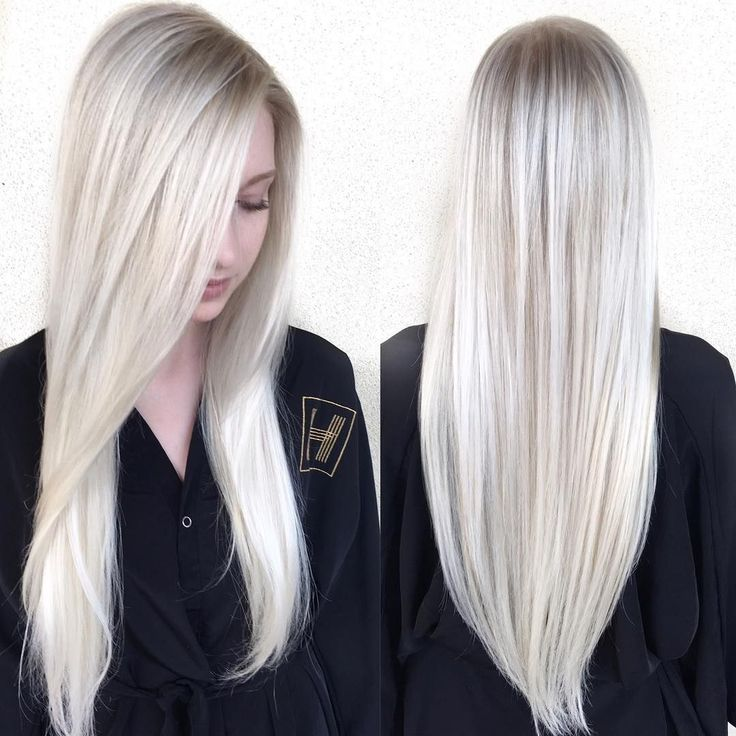 This Sleek Platinum Blonde Hair with Side Part and V-Cut Layers is a great look for someone seeking a classic feminine style. This long layered cut can be worn sleek and straight, with textured waves or curls, or with a simple blowout for body and movement. It is also long enough to create updos and braids. Styling tips for this long layered haircut and other similar long hairstyles, long bobs, and hair color ideas can be found at Hairstyleology.com