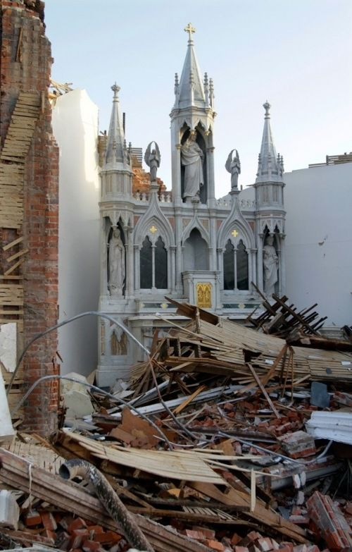 Saint Joseph Catholic Church in Ridgway, Illinois, that was totoally destroyed by a tornado. The High Altar Remains, with Jesus having reigned peacefully through the storms.
