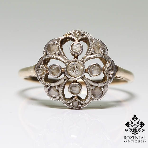 Period: Edwardian (1901-1920) Composition: 18 K Gold & Platinum Stones: - 1 Old mine cut diamond of I-SI1 quality that weighs 0.15ctw. - 11 Rose cut diamonds of J-SI2 quality that weigh 0.25ctw. Ring