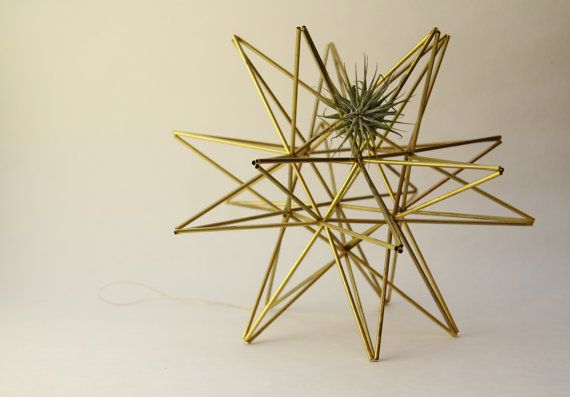 This set of two brass sculptures are my modern take on Scandinavian himmeli mobiles. They are delicate pieces. The Moravian Star and pollen ball look perfect on a shelf of a desk. They add life to a dull room and display air plants uniquely and beautifully. Dimensions - Moravian Star