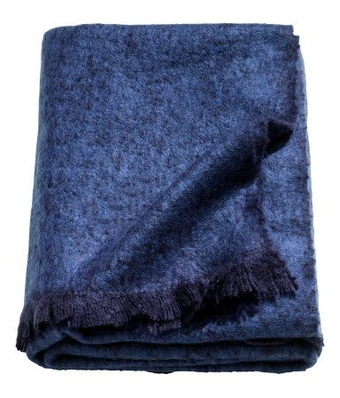 Dark blue. Throw in soft, woven melange fabric with fringe on short sides.