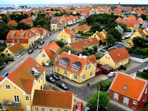 Skagen, the area is picturesque, and distinguished by its low, yellow houses with red tile roofs nestled into the beach areas. The impressive and wild landscape was largely formed by a severe process of desertification that hit the area in the 18th and 19th centuries.