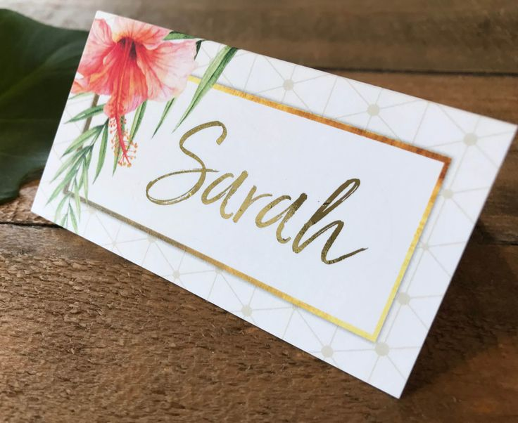 A set of gold and white tropical place cards | tent cards | escort cards with palms, hibiscus flowers and a geometric pattern and optional metallic foil. Perfect for a beach, summer or island wedding!