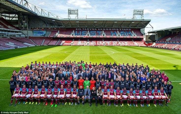 West Ham's players, coaches, staff and directors pose  for the team photo as the club prepares to leave Upton Park at the end of the season