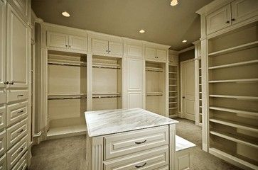 MICHAEL MOLTHAN LUXURY HOMES traditional closet organizers