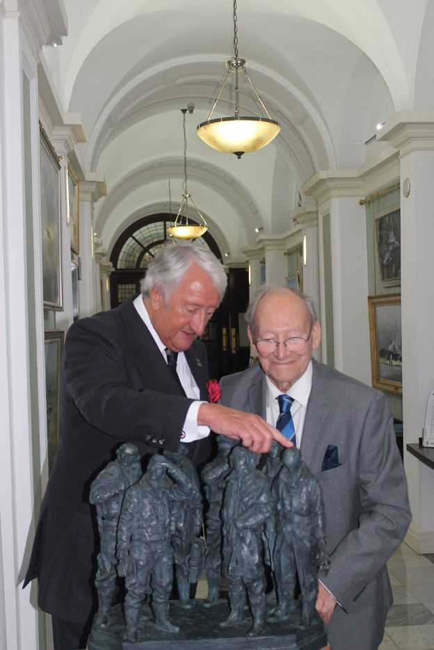 Michael Oliver OBE DL with RAF veteran Doug Radcliffe, at the moment of donating the maquette of the RAF Club to the Royal Air Force Benevolent Fund whom will place it on permanent display at the RAF Club.
