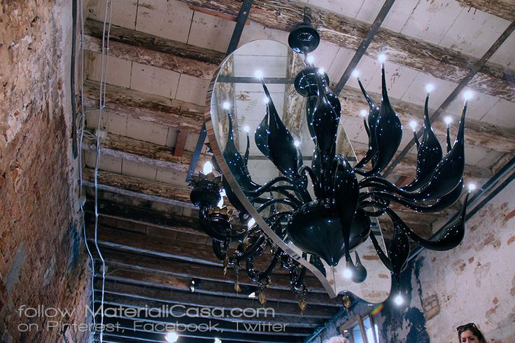 Murano handmade glass chandelier.   Half classic, half ultra-modern. In the middle: a mirror that reflects. The best of Made in Italy! (Venice). #biennalearchitettura2016 MaterialiCasa.com photoreport. Follow us!