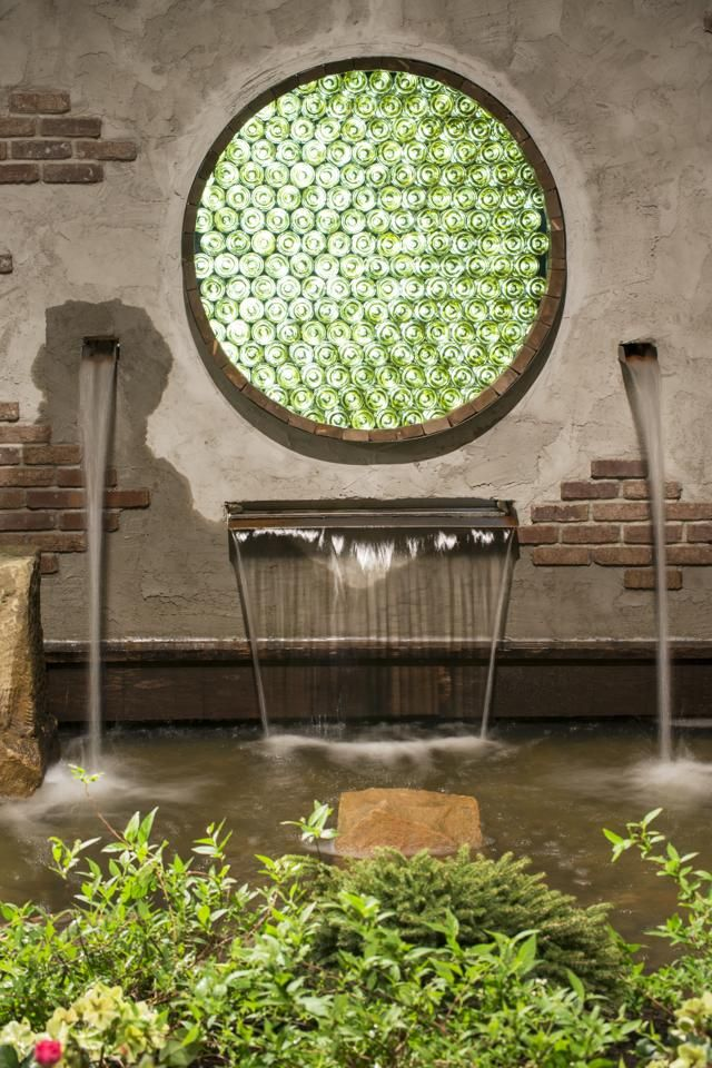 Garden Wall Features A Fountain And A Recycled Glass Window From The Ohio Valley Group