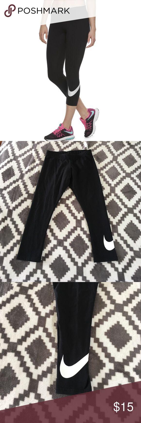 """Nike Swoosh Graphic Capri Leggings Screen-printed Nike Swoosh logo at left calf Elastic waistband for flexible movement, 22"""" inseam in great shape size M Nike Pants Leggings"""