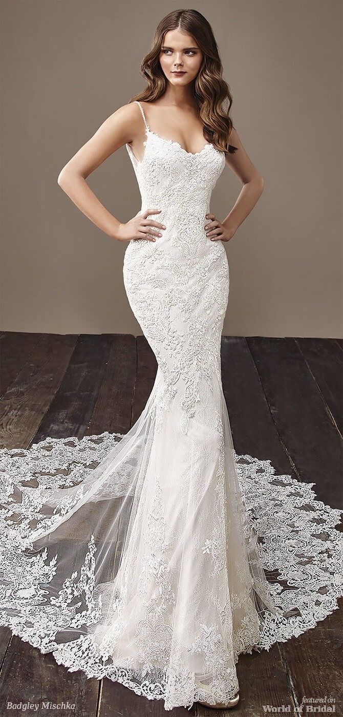 Sleek and feminine, this full-length mermaid gown is adorned with soft, romantic lace and a classic sweetheart neckline. Crystal stones embellish the thin straps and extend along the edge of the illusion lace back. Complete with a stunning lace train.